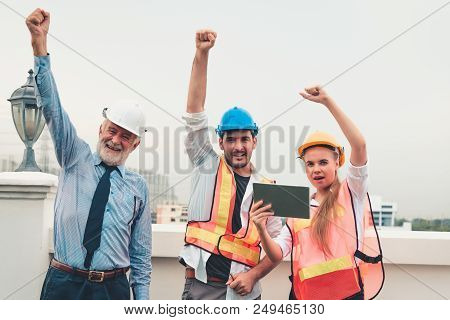 Portrait Of Engineering Teamwork Are Showing Hands Up After Business Successful., Construction Teamw