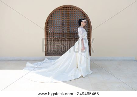 Fairytale Dress. Things Consider For Wedding Abroad. Bride Adorable White Wedding Dress Sunny Day Ar