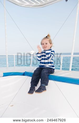 Best Cruises For Kids. Kid Boy Toddler Travelling Sea Cruise. Child In Striped Shirt Looks Like Youn