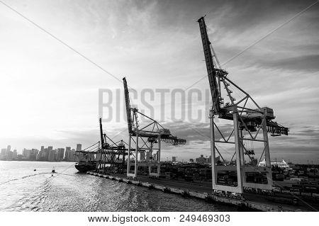 Miami, Usa - March, 18, 2016: Maritime Container Port With Cargo Ship In Miami, Cranes. Trade, Comme
