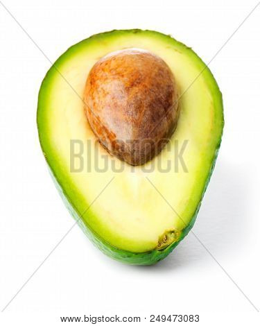 Half Of Ripe Avocado With Seed Isolated On White Background