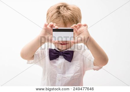 Boy Showing Blank Credit Card. Credit Card. Cash. Business-card. Plastic Bank Card With Magstripe. E