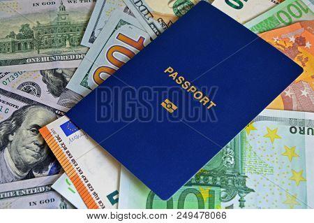 Biometric Passport Is On Paper Euro Bills And Dollars. Concept: Increase Of Salaries, Work In Europe