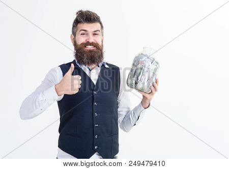 Portrait Of Excited Businessman Holds Jar With Money And Piggy Bank. Bank Advertising. Saving Money