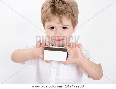 Boy Showing Blank Credit Card. Credit Card. Cash Card. Business-card. Copy Space For Bank Advertisin