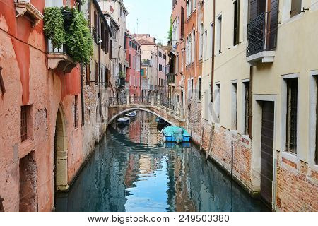 View Of Canal With Bridge And Boats In Venice, Italy, Europe