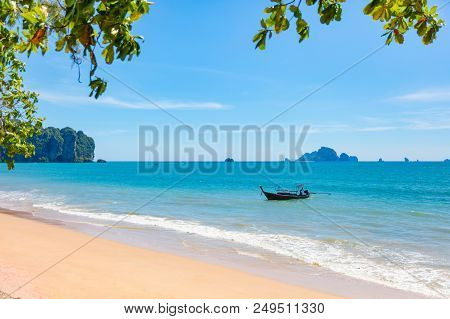 Longtail Boat In Sea At Aonang Beach Against Sky On Sunny Day