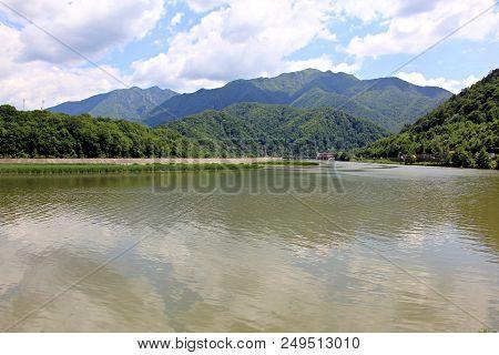 Olt River. European Route E81 Passing Through Mountains Next To The Olt River In Romania.