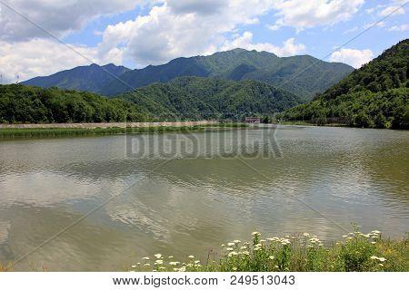 Olt River Gorge. European Route E81 Passing Through Mountains Next To The Olt River In Romania.