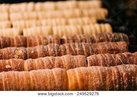 Prague, Czech Republic. Trdelnik Or Trdlo Is A Traditional Delicacy, Found In A Number Of Countries In Central Europe. It Is A Batch Of Yeast Dough, Wound On A Spit Of Wood Or Metal In A Spiral. poster