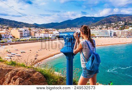 Tourist Woman In Badia Bay In Tossa De Mar In Girona, Catalonia, Spain Near Of Barcelona. Ancient Me