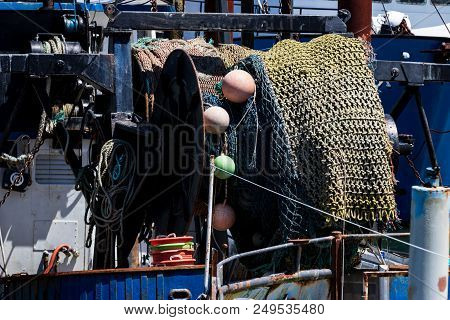 Fishing Net And Float Reel Mounted On A Vessel Reeled In