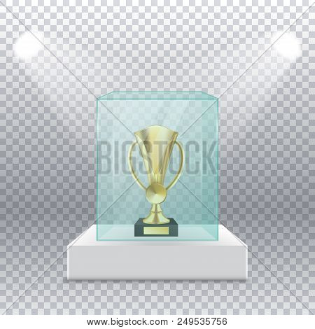Gold Cup On A Pedestal In A Glass Box With Spotlights Back On A Transparent Background. Realictic Go