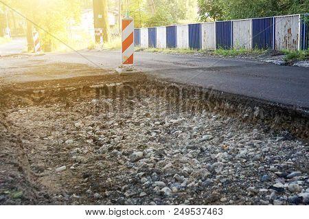 Showing A Line Of Street Cones. Dismantling Of Asphalt, Repair Of The Road, Large Pit On The Asphalt