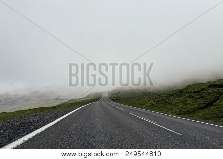 Empty Foggy And Misty Asphalt Road Through The The Mountain, No Ending Unknown Future Ahead With Cop