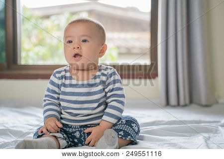 The Little Boy In The Bedroom In Bed.