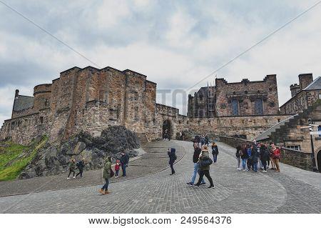 Edinburgh, Scotland - April 2018: Tourists At Foog Gate, The Principle Gate To The Upper Ward Inside