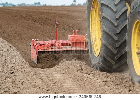 Tractor Harvester Working On The Field