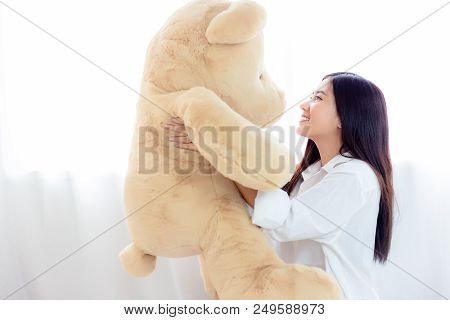 Portrait Charming Beautiful Woman. Attractive Beautiful Girl Is Holding A Big Teddy Bear In Morning
