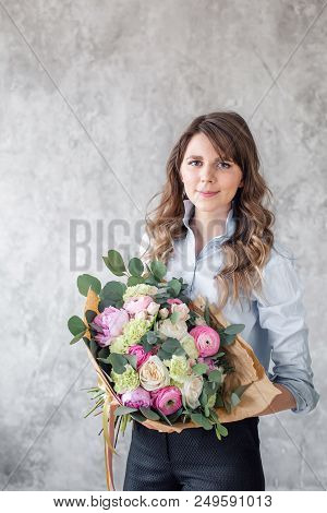 Woman Florist Creating Beautiful Bouquet In Flower Shop. Working In Flower Shop. Girl Assistant Or O