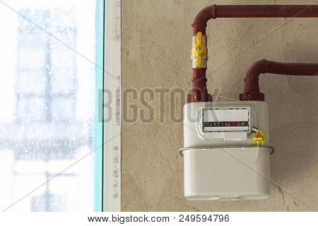 Gas meter in a house under renewal. Indoor gas meter used for measuring natural gas consumption in buildings / houses. poster