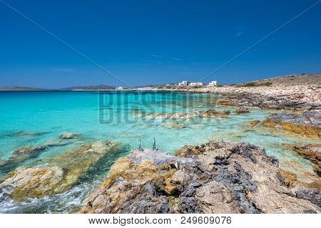 Rocky beach with amazing tranquil water on Paros island, Cyclades, Greece.