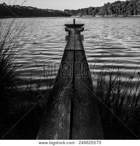 Wood pontoon on pond of Montperché pond in summer, Sologne, France