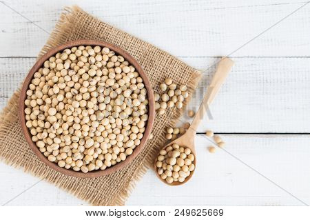 White Wood Floor With Wooden Cup With Soybean,top View And Copys Pace,soybeans In Wooden Bowl With W