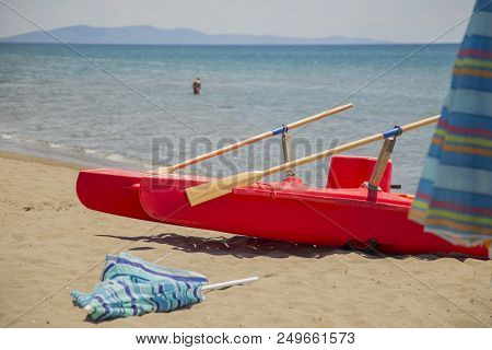 Mage Of A Rowing Boat On The Beach With Sea In Background