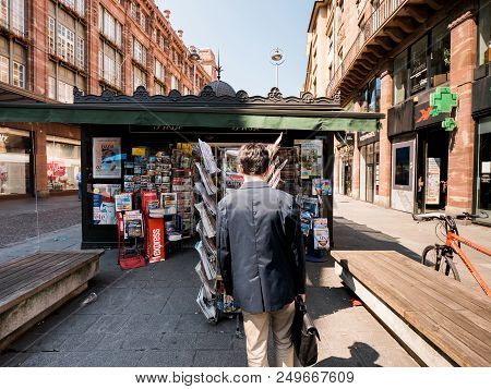 Strasbourg, France - Jul 16, 2018: Rear View Of Man Buying Newspapers Announcing France Champion Tit