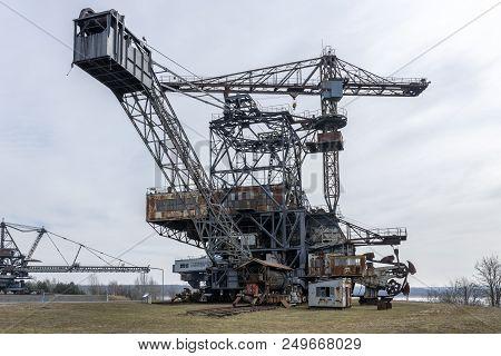 Gigantic excavator in the disused lignite opencast Ferropolis, Stadt aus Eisen, Sachsen-Anhalt, East Germany poster