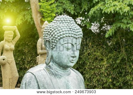 Buddhism / Buddha Statue In A Very Beautiful Park