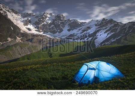 Night Landscape Of Mountains And A Tent Of Tourists In Svaneti, Georgia. Camp In Mountain At Night.