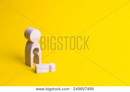 A Wooden Figure Of A Woman With A Void From Which A Child Fell. The Concept Of The Loss Of A Child,