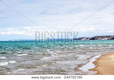 Lake Michigan With Its Beautiful Colors, Whitecaps, And A Sandy Beach In March