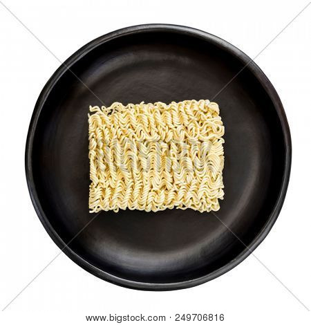 Raw Asian instant ramen noodles, isolated on white, in black bowl.  Top view.