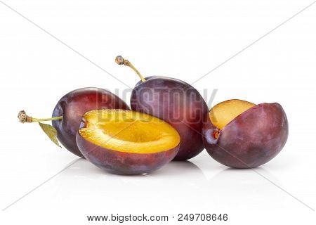 Group Of Three Whole One Half One Piece Of Fresh Violet-blue Plum Vibrant Moyer Variety Isolated On