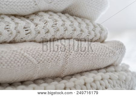Background With Warm Sweaters. Pile Of Knitted Clothes In Warm Shades, Warm Background, Knitwear, Sp
