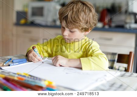 Tired Little Kid Boy At Home Making Homework At The Morning Before The School Starts. Little Child D