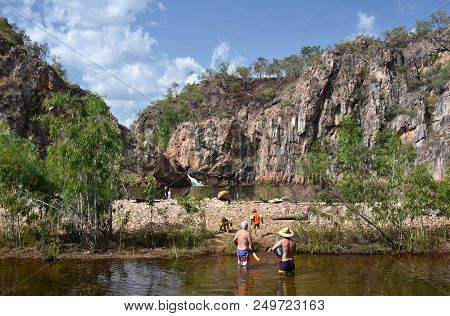 People Swimming In The Waterhole At Edith Falls, Which Is A Series Of Cascading Waterfalls And Pools