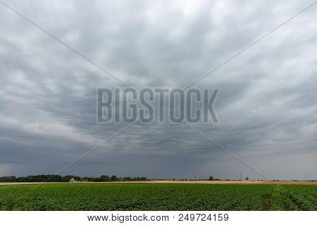 Overcast Sky Over Rural Landscape. Stock Photo.