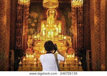 Photographer Capture Gold Buddha Figure In Thailand Temple