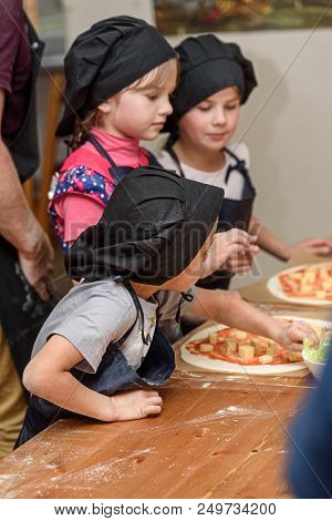 Pizza, Children And The Concept Of Cooking - Children Make Pizza. Preparation Of Pizza, A Master Cla