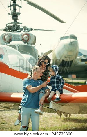 Travelling Concept. Family At Retro Planes Parked On Ground, Travelling. Child With Mother And Fathe