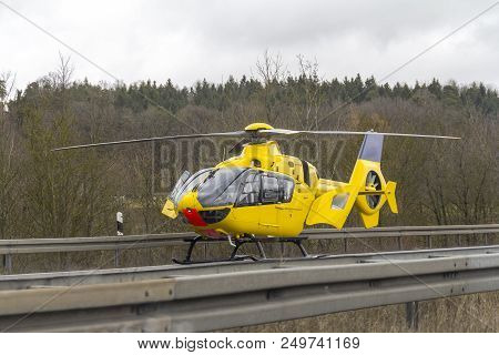 Roadside Scenery Including A Yellow Rescue Helicopter