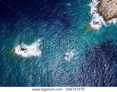 Aerial above rocky coastline