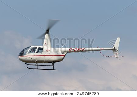Raf Fairford, Gloucestershire, Uk - July 10, 2014: Robinson R-44 Raven Ii Light Four Seat Helicopter