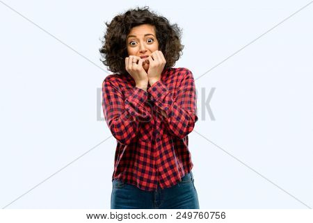 Beautiful arab woman terrified and nervous expressing anxiety and panic gesture, overwhelmed