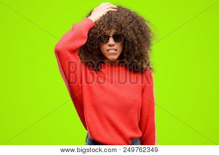 African american woman wearing sunglasses terrified and nervous expressing anxiety and panic gesture, overwhelmed