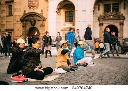 Prague, Czech Republic - September 23, 2017: Chinese People Are Engaged In Meditation Falun Gong Or